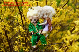 Tiny Dolls in Forsythia Bushes