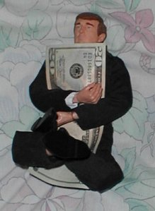 Donald Trump doll clings to a twenty dollar bill