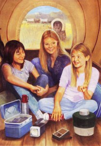 Three's company as April, Tracy and Julie cram together in a covered wagon.